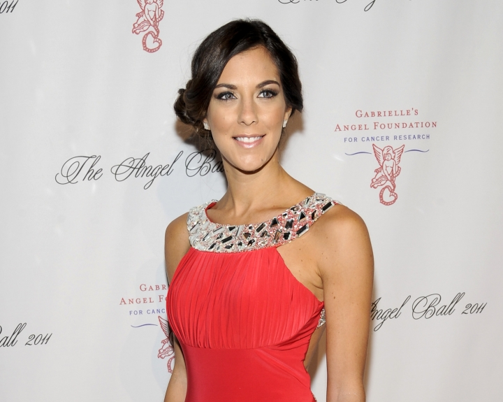 "FILE - In this Oct. 17, 2011 file photo, reality TV personality Jenna Morasca attends the Gabrielle's Angel Foundation for Cancer Research Angel Ball honors gala in New York. Police say Morasca, a winner of the reality TV show ""Survivor,"" bit a police officer after being found unconscious in her parked car and revived with the opioid overdose antidote Narcan. A police report obtained by the Observer-Reporter newspaper says the 37-year-old became combative during the Jan. 25 incident near a McDonalds restaurant 30 miles south of Pittsburgh. (AP Photo/Evan Agostini, File)"