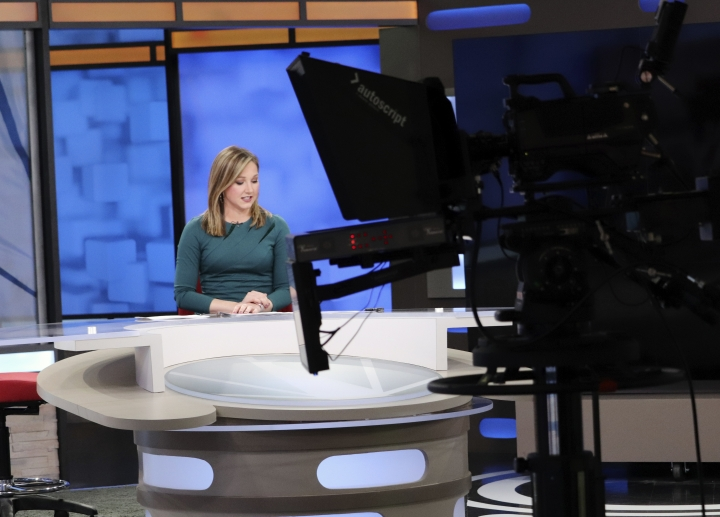 "In this Feb. 1, 2018, photo, Stephanie Sharp at KARK-TV in Little Rock, Ark., takes a break during the noon newscast. Sharp opposes a radio station's ""Babe Bracket,"" which pits 16 local female television personalities in a tournament-like personality contest. A reporter at a competing station, who was last year's runner-up, started a protest Thursday, Feb. 15, 2018, saying the women's professional accomplishments are being ignored. (AP Photo/Kelly P. Kissel)"