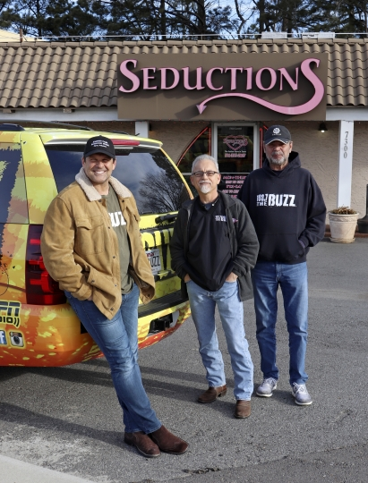 "In this Feb. 2, 2018, photo, radio show hosts from left, David Bazzel, Roger Scott and Tommy Smith, pose outside a lingerie shop where they hosted their show in Little Rock, Ark. The three run an annual contest called the ""Babe Bracket,"" which pits 16 local female television personalities in a tournament-like personality contest. Last year's runner-up says the contest ignores the women's professional accomplishments and she started a protest on Twitter on Thursday, Feb. 15, 2018. (AP Photo/Kelly P. Kissel)"