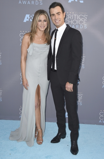 FILE - In this Jan. 17, 2016 file photo, Jennifer Aniston, left, and Justin Theroux arrive at the 21st annual Critics' Choice Awards in Santa Monica, Calif. The couple announced Thursday, Feb. 15, 2018, that they have separated. (Photo by Jordan Strauss/Invision/AP)