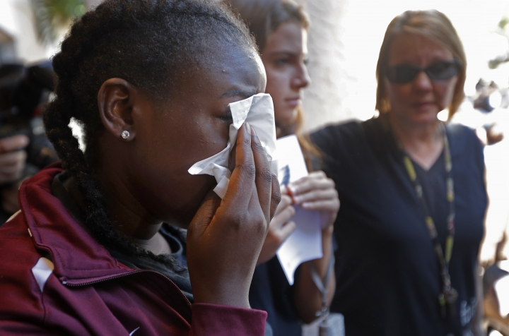 Marla Eveillard, 14, cries before the start of a vigil at the Parkland Baptist Church, for the victims of the Marjory Stoneman Douglas High School shooting in Parkland, Fla., Thursday, Feb. 15, 2018. Nikolas Cruz, who had been expelled from the school, opened fire there yesterday, killing at least 17 people. (AP Photo/Gerald Herbert)