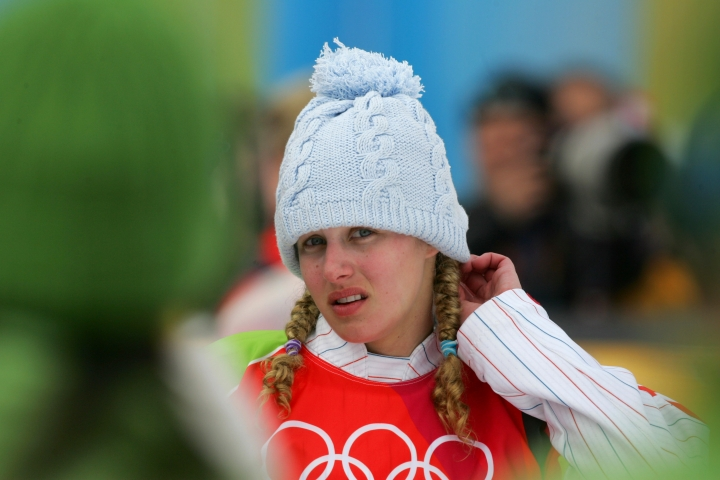 FILE - In this Friday, Feb. 17, 2006 file photo, silver medallist Lindsey Jacobellis, of the United States, reacts prior to the flower ceremony of the Women's Snowboard Cross competition at the Turin 2006 Winter Olympic Games in Bardonecchia, Italy. Jacobellis says she's long since moved past her misstep that cost her a gold medal at the 2006 Olympics. Jacobellis was leading in the women's snowboardcross finals when she fell after trying to showboat a bit on her way to the finish line. The mistake forced her to settle for silver. (AP Photo/Peter Dejong, File)