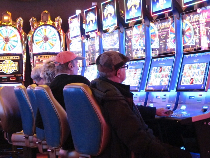 This Jan. 31, 2018 photo shows gamblers playing slot machines at the Tropicana casino in Atlantic City N.J. Having lost its casino license a decade ago after former owners made drastic cuts that left it filthy, understaffed and losing customers, the Tropicana under the ownership of billionaire investor Carl Icahn has become the No. 2 casino in Atlantic City in terms of overall gambling revenue, trailing only the Borgata. (AP Photo/Wayne Parry)