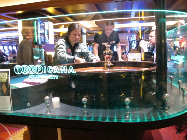 This Jan. 31, 2018 photo shows a dealer conducting a game of roulette at the Tropicana casino in Atlantic City N.J. Having lost its casino license a decade ago after former owners made drastic cuts that left it filthy, understaffed and losing customers, the Tropicana under the ownership of billionaire investor Carl Icahn has become the No. 2 casino in Atlantic City in terms of overall gambling revenue, trailing only the Borgata. (AP Photo/Wayne Parry)