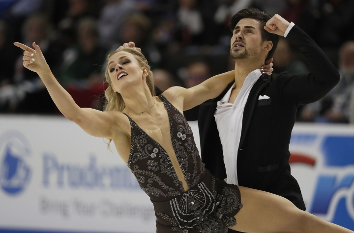 FILE - In this Jan. 7, 2018, file photo, Madison Hubbell, left, and Zachary Donohue perform during the free dance event at the U.S. Figure Skating Championships in San Jose, Calif. American ice dancer Hubbell and her partner, Donohue, still rely on her mother to design and sew their costumes. (AP Photo/Tony Avelar, File)