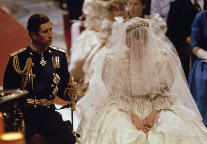 FILE - In this July 29, 1981 file photo, Prince Charles and Lady Diana Spencer on their wedding day at St. Paul's Cathedral in London. With Prince Harry and Meghan Markle's May 19 wedding fast approaching, the fashion and bridal worlds are abuzz with talk of who the bride will pick to design her dress and what kind of look she would go for. (AP Photo, File)