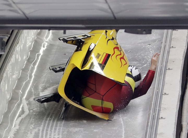 Driver Nico Walther and Christian Poser of Germany crash in the finish area after the second run during the two-man bobsled competition at the 2018 Winter Olympics in Pyeongchang, South Korea, Sunday, Feb. 18, 2018. (AP Photo/Michael Sohn)