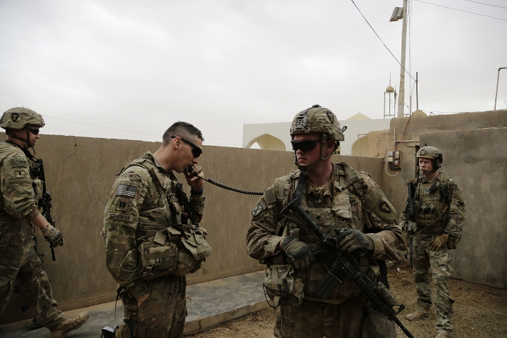 In this Jan. 25, 2018, photo, American troops coordinate with Iraqi counterparts to launch airstrikes and artillery from a small complex in the town of Qaim, Iraq. As the fight against IS in Syria grinds on, Iraqi troops stationed in western Iraq near the border continue to call on coalition forces for help sharing intelligence and launching strikes. Thousands of U.S. troops and billions of dollars spent by Washington helped bring down the Islamic State group in Iraq, but many of the divisions and problems that helped fuel the extremists' rise remain. (AP Photo/Susannah George)