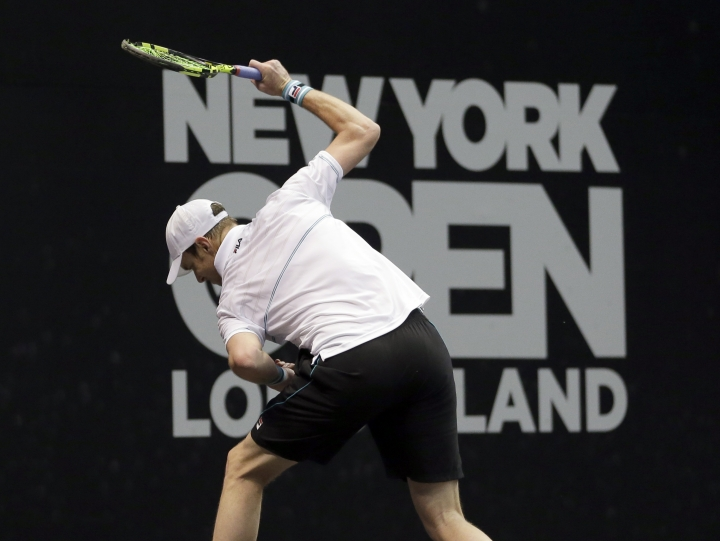Sam Querrey, of the United States, slams his racket on the court during his finals match against Kevin Anderson, of South Africa, at the New York Open tennis tournament in Uniondale, N.Y., Sunday, Feb. 18, 2018. (AP Photo/Seth Wenig)