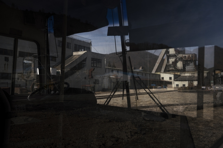 An abandoned coal mine is seen through the inside of an old bus used to transport workers in the town of Sabuk, Jeongseon county, South Korea, Thursday, Feb. 15, 2018. (AP Photo/Felipe Dana)