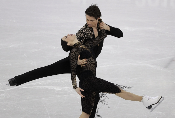 Tessa Virtue and Scott Moir of Canada perform during the ice dance, short dance figure skating in the Gangneung Ice Arena at the 2018 Winter Olympics in Gangneung, South Korea, Monday, Feb. 19, 2018. (AP Photo/David J. Phillip)