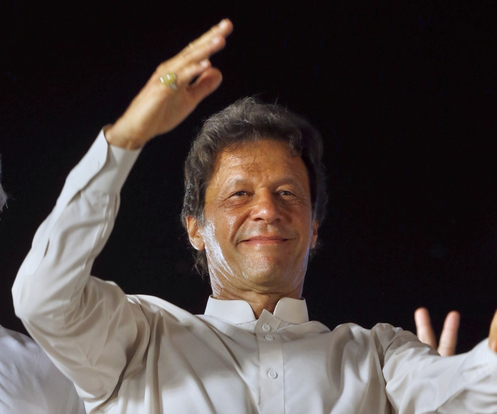 FILE - In this July 30, 2017, file photo, opposition leader Imran Khan of the Pakistan Taherik-e-Insaf party waves to supporters during a rally in Islamabad, Pakistan. Khan's party announced Monday, Feb. 19, 2018 that Pakistani cricket legend turned politician Khan has married a faith healer, ending rumors that he was considering a third marriage after divorcing two wives. (AP Photo/Anjum Naveed, File)