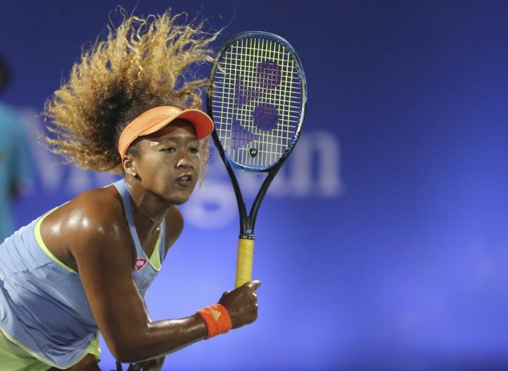 Naomi Osaka of Japan returns the ball to Kristina Mladenovic of France during the Dubai Duty Free Tennis Championship in Dubai, United Arab Emirates, Monday, Feb. 19, 2018. (AP Photo/Kamran Jebreili)