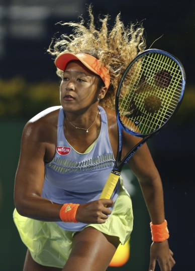 Naomi Osaka of Japan returns the ball to Kristina Mladenovic of France during the Dubai Duty Free Tennis Championship in Dubai, United Arab Emirates, Monday, Feb. 19, 2018. (AP Photo/Kamran Jebreili)