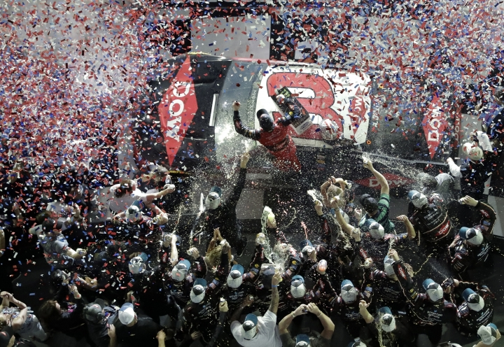 Austin Dillon, center, celebrates on his car with crew members in Victory Lane after winning the NASCAR Daytona 500 auto race at Daytona International Speedway, Sunday, Feb. 18, 2018, in Daytona Beach, Fla. (AP Photo/John Raoux)