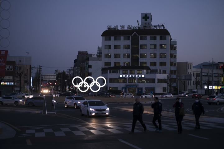 FILE - In this Feb. 3, 2018 photo, illuminated Olympic rings shine at dusk prior to the 2018 Winter Olympics in Gangneung, South Korea. As South Korea basks in the glow of daily competition and global attention, hope is fading that Pyeonchgang will do what was promised during its successful 2011 Olympics bid and turn an ignored, impoverished backwater into a premier Asian ski hub. (AP Photo/Felipe Dana, File)