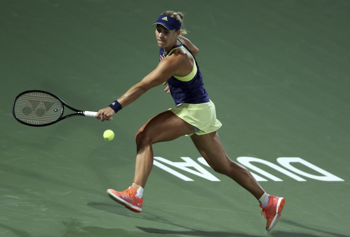 Angelique Kerber of Germany returns the ball to Barbora Strycova of Czech Republic during the Dubai Duty Free Tennis Championship in Dubai, United Arab Emirates, Tuesday, Feb. 20, 2018. (AP Photo/Kamran Jebreili)