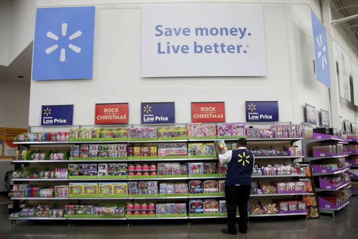 FILE- In this Nov. 9, 2017, file photo, Walmart employee Kenneth White scans items while conducting an exercise during a Walmart Academy class session at the store in North Bergen, N.J. Walmart reports financial results Tuesday, Feb. 20, 2018. (AP Photo/Julio Cortez, File)