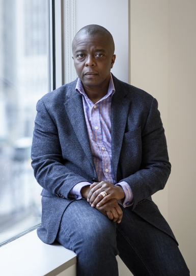 """In this Feb. 9, 2018 photo, filmmaker Yance Ford poses for a portrait in New York to promote his Oscar-nominated documentary """"Strong Island."""" The film, a Netflix release, is Ford's investigation into the 1992 killing of his brother, William Ford, in Central Islip, N.Y. The 22-year-old Ford was shot and killed by a 19-year-old white man after a verbal altercation. (Photo by Christopher Smith/Invision/AP)"""