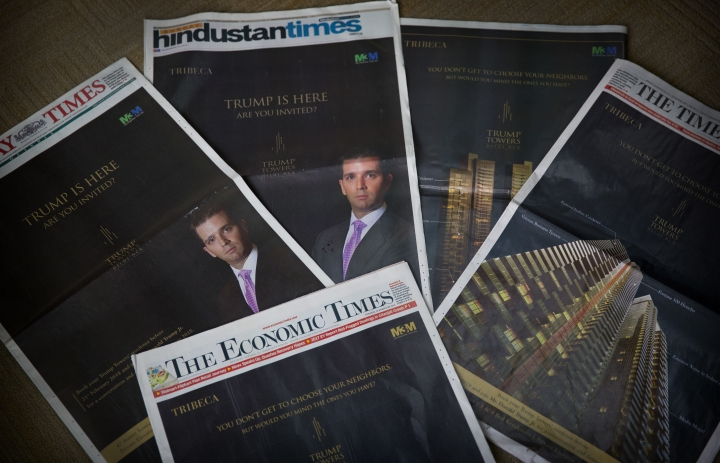 """The eldest son of US President Donald Trump, Donald Trump Jr's Trump Towers ads are seen in major newspapers in New Delhi, India, Tuesday, Feb. 20, 2018. """"Trump has arrived. Have you?"""" shout the barrage of glossy front-page advertisements in almost every major Indian newspaper. The ads, which have run repeatedly in the past few days, herald the arrival not of the American president but of his eldest son, Donald Trump Jr., who is in New Delhi to sell luxury apartments and lavish attention on wealthy Indians who have already bought units in a Trump-branded development outside of the Indian capital. (AP Photo/Manish Swarup)"""