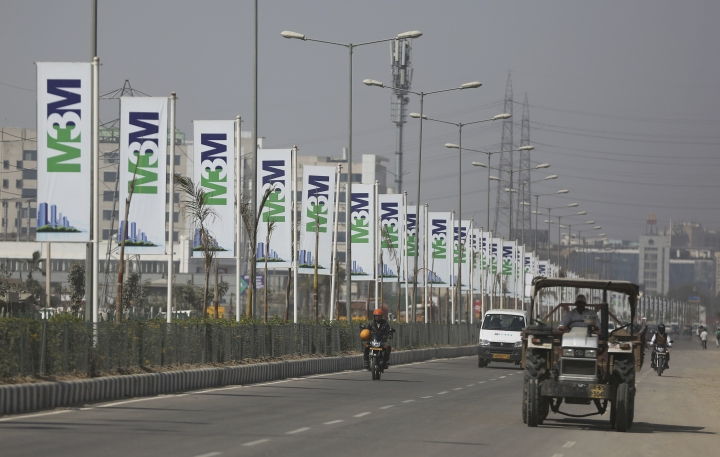 Vehicles drive past billboards of M3M developers near the proposed site for the Trump Towers in Gurgaon, a suburb of New Delhi, India, Tuesday, Feb. 20, 2018. The eldest son of U.S. President Donald Trump has arrived in India to help sell luxury apartments and lavish attention on wealthy Indians who have already bought units in a string of Trump-branded developments. (AP Photo/Altaf Qadri)