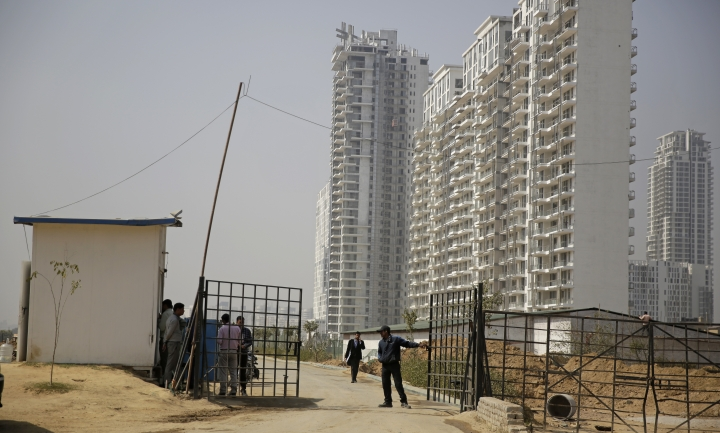 A security man closes a gate leading to the proposed site for the Trump Towers in Gurgaon, a suburb of New Delhi, India, Tuesday, Feb. 20, 2018. The eldest son of U.S. President Donald Trump has arrived in India to help sell luxury apartments and lavish attention on wealthy Indians who have already bought units in a string of Trump-branded developments. (AP Photo/Altaf Qadri)
