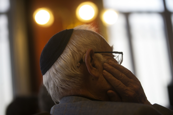 A man wearing a Jewish yarmulke listens during a news conference at the Royal Spanish Academy in Madrid, Tuesday, Feb. 20, 2018. More than five centuries after their ancestors were kicked out of Spain, Sephardic Jews are closer to being granted an academic body to oversee and protect the Ladino or Judeo-Spanish, a language with the sounds of a medieval Spanish that has been passed on almost intact for generations. (AP Photo/Francisco Seco)