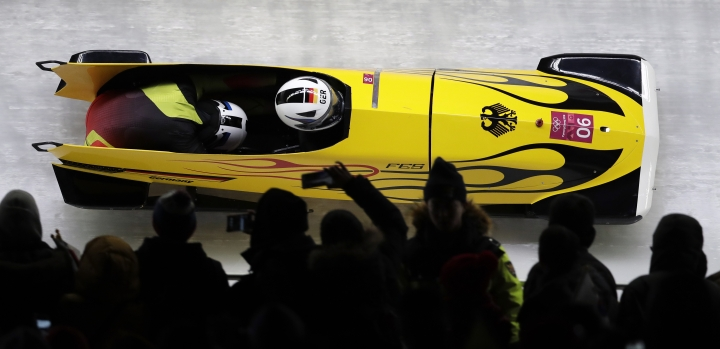 Driver Mariama Jamanka and Lisa Buckwitz of Germany take a curve in their third heat during the women's two-man bobsled final at the 2018 Winter Olympics in Pyeongchang, South Korea, Wednesday, Feb. 21, 2018. (AP Photo/Michael Sohn)