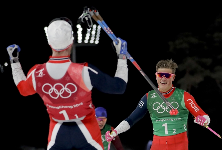 Norway's Martin Johnsrud Sundby, left, and Johannes Hoesflot Klaebo celebrate after winning the gold medal in the men's team sprint freestyle cross-country skiing final at the 2018 Winter Olympics in Pyeongchang, South Korea, Wednesday, Feb. 21, 2018. (AP Photo/Matthias Schrader)