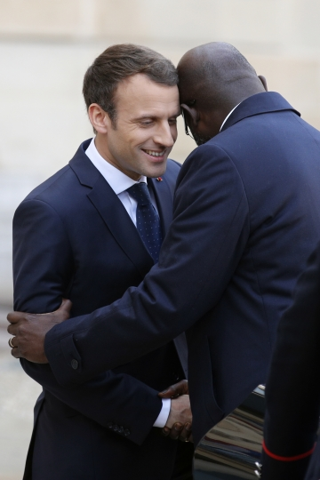 French President Emmanuel Macron welcomes Liberia's recently-elected President George Weah upon his arrival at the Elysee Palace, in Paris, France, Wednesday, Feb. 21, 2018. The French presidency said discussions will notably focus on launching a fund dedicated to sports projects in Africa. (AP Photo/Francois Mori)