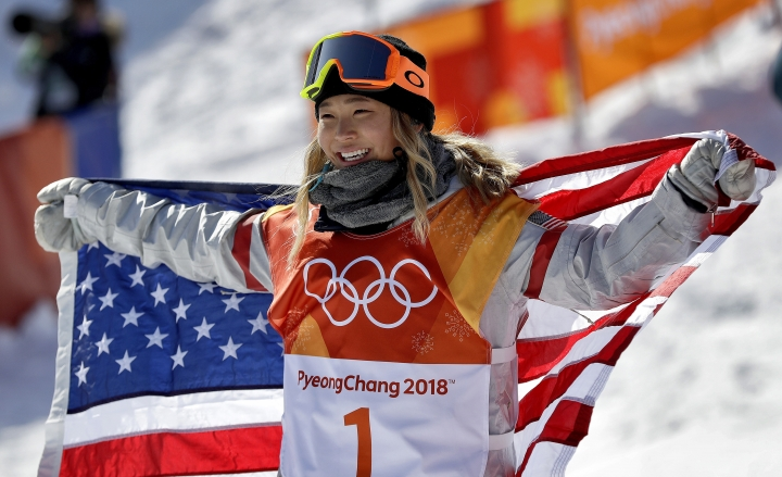 FILE- In this Feb. 13, 2018, file photo, Chloe Kim, of the United States, celebrates winning gold after the women's halfpipe finals at Phoenix Snow Park at the 2018 Winter Olympics in Pyeongchang, South Korea. Before Kim won gold in the snowboarding halfpipe event, her infectious personality and heartwarming origin story had already won her sponsorships from Toyota, Samsung, Visa and others. (AP Photo/Gregory Bull, File)