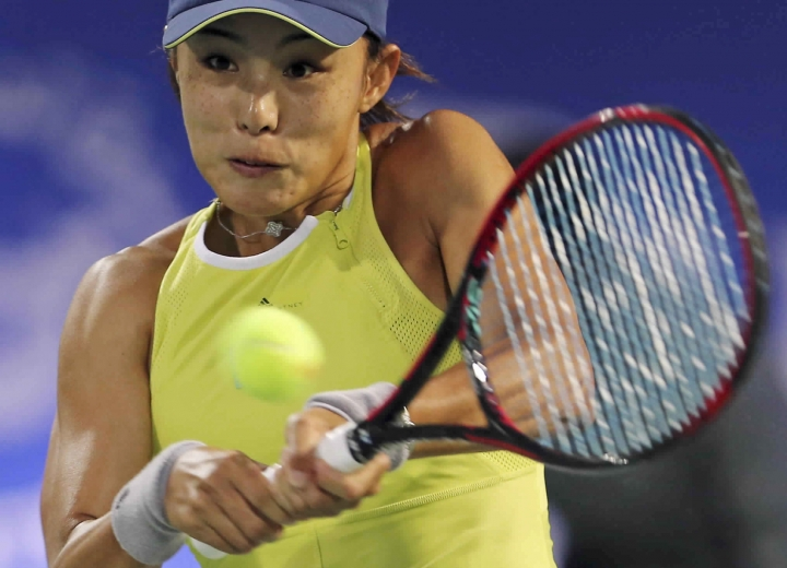 Qiang Wang of China returns the ball to Elina Svitolina of Ukraine during the Dubai Duty Free Tennis Championship in Dubai, United Arab Emirates, Wednesday, Feb. 21, 2018. (AP Photo/Kamran Jebreili)