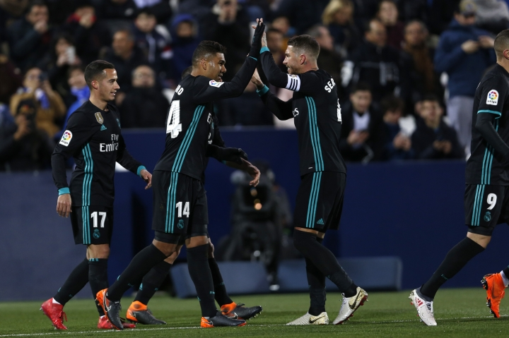 Real Madrid's Casemiro, second left, celebrates with teammate Sergio Ramos after scoring his side's second goal against Leganes during a Spanish La Liga soccer match between Real Madrid and Leganes at the Butarque stadium in Leganes, outside Madrid, Wednesday, Feb. 21, 2018. (AP Photo/Francisco Seco)