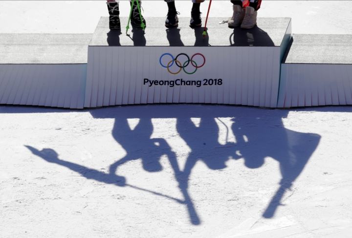 Austria's Anna Veith, silver, Czech Republic's Ester Ledecka, gold, and Liechtenstein's Tina Weirather, bronze, from left, celebrate during the venue ceremony for the women's super-G at the 2018 Winter Olympics in Jeongseon, South Korea, Saturday, Feb. 17, 2018. (AP Photo/Charlie Riedel)