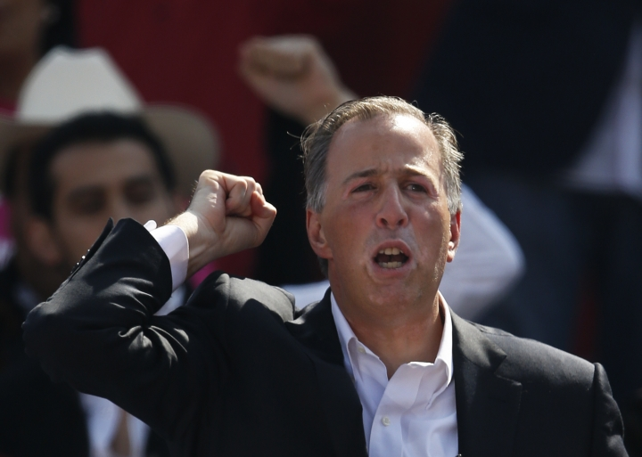 Jose Antonio Meade gestures to supporters during an event naming him the presidential candidate for the Institutional Revolutionary Party (PRI) in Mexico City, Sunday, Feb. 18, 2018. On Sunday, Mexico's three major political parties are nominating their presidential candidates for the July 1 election. (AP Photo/Marco Ugarte)