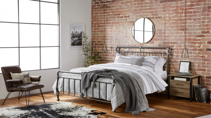 This undated artist rending provided by Walmart shows their industrial bedroom, which is part of Walmart's new online home shopping experience that will let shoppers discover items based on their style. The move, announced Thursday, Feb. 22, 2018, is the first glimpse of Walmart's broader efforts to redesign its site with a focus on fashion and home furnishing. (Walmart via AP)