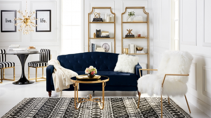 This undated artist rending provided by Walmart shows their glam living room, which is part of Walmart's new online home shopping experience that will let shoppers discover items based on their style. The move, announced Thursday, Feb. 22, 2018, is the first glimpse of Walmart's broader efforts to redesign its site with a focus on fashion and home furnishing. (Walmart via AP)