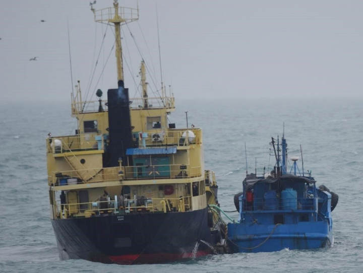 "FILE - In the this Feb. 16, 2018, file photo released by Japan's Ministry of Defense shows what it says North Korean-flagged tanker Yu Jong 2, left, and Min Ning De You 078 lying alongside in the East China Sea. China says it is ""highly concerned"" about a reported ship-to-ship transfer on the high seas that could violate U.N. sanctions on North Korea. (Ministry of Defense via AP, File)"