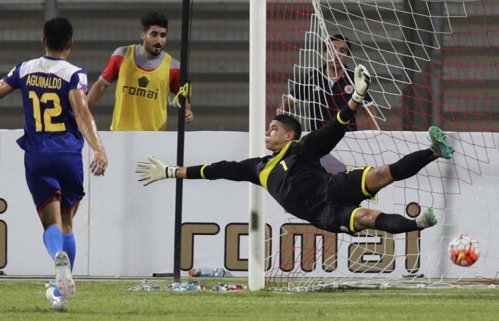 FILE - In this Tuesday, Oct. 13, 2015, file photo, Philippines' goalkeeper Neil Etheridge fails to block a Bahrain goal during a preliminary joint qualifier for the 2018 FIFA World Cup and the 2019 AFC Asian Cup in Riffa, Bahrain. Cardiff City goalkeeper Etheridge may not just become the first southeast Asian to play in the English Premier League later this year, he could also help develop soccer in the Philippines, on and off the field. (AP Photo/Hasan Jamali)