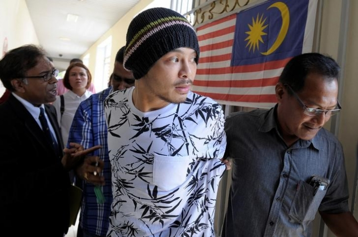 FILE PHOTO: Malaysian rapper Wee Meng Chee, whose stage name is Namewee, is pictured leaving a courtroom in Penang, Malaysia August 25, 2016. REUTERS/Stringer