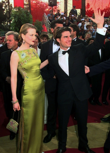 FILE - In this March 24, 1997 file photo, Tom Cruise and Nicole Kidman arrive for the 69th Annual Academy Awards in Los Angeles. Kidman wore an embellished chartreuse Dior dress by John Galliano. (AP Photo/Chris Pizzello, File)