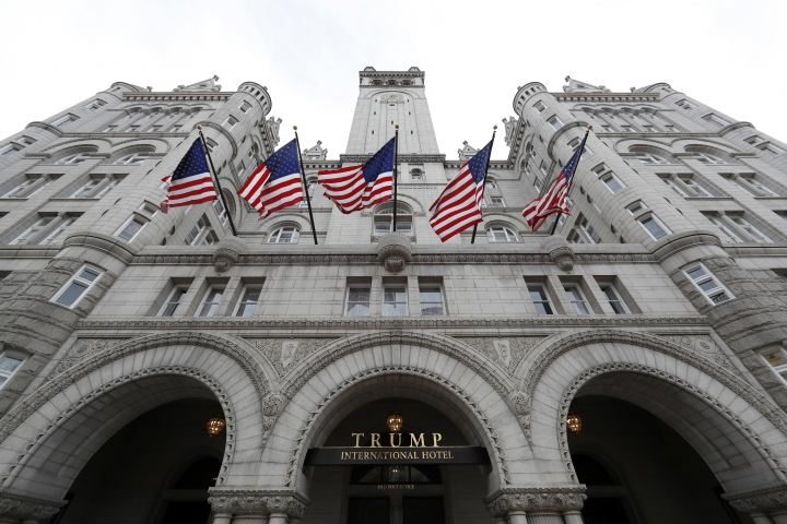 """FILE - In this Dec. 21, 2016, file photo, the Trump International Hotel in Washington. Special interests are holding meetings at properties owned by President Donald Trump, putting money in his pockets as they seek to influence his administration. An Associated Press analysis of the interest groups that visited Trump properties in the first year of his presidency found several instances that at least created the appearance of """"pay for play."""" (AP Photo/Alex Brandon, File)"""