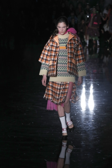 A model wears a creation as part of the Prada women's Fall/Winter 2018-2019 collection, presented during the Milan Fashion Week, in Milan, Italy, Thursday, Feb. 22, 2018. (AP Photo/Antonio Calanni)