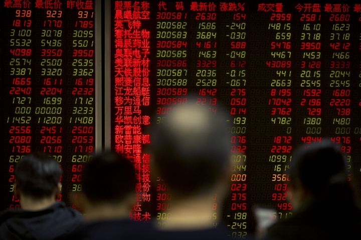 Chinese investors monitor stock prices at a brokerage house in Beijing, Friday, Feb. 23, 2018. Asian stocks advanced Friday after Wall Street rebounded from a two-day losing streak and Japanese inflation edged higher. (AP Photo/Mark Schiefelbein)