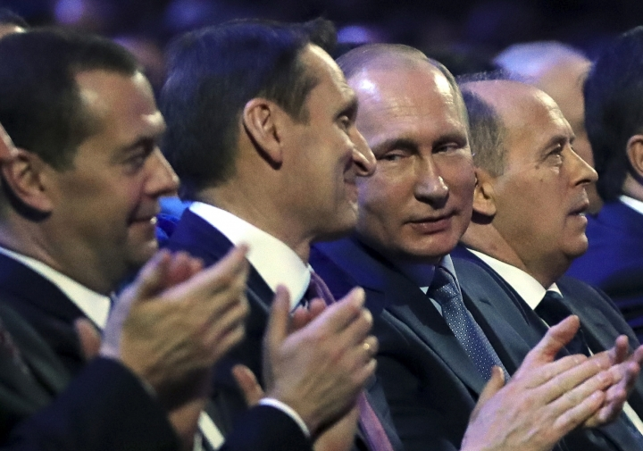 FILE In this file photo taken on Wednesday, Dec. 20, 2017, President Vladimir Putin, second right, Sergei Naryshkin, head of the Russian Foreign Intelligence Service, second left, Prime Minister Dmitry Medvedev, left, Federal Security Service (FSB) Director Alexander Bortnikov, attend meeting with intelligence officers on their professional holiday in Moscow, Russia. The Russian president's reluctance to adopt the hyperconnected world's technology might seem at odds with the wide belief that he signed off on campaign to undermine the United States via social media. (Mikhail Klimentyev, Sputnik, Kremlin Pool Photo via AP, File)