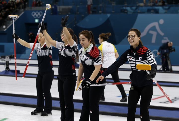 """In this Feb. 21, 2018 photo, South Korea's women's curling team celebrate after beating Russian athletes during their match at the 2018 Winter Olympics in Gangneung, South Korea. The team known as the """"Garlic Girls"""" came into the Pyeongchang Games as the underdog who few believed would medal. Now they're No. 1 in the rankings. (AP Photo/Aaron Favila)"""