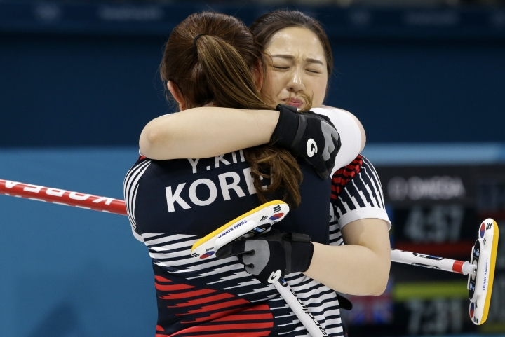 South Korea's Kim Kyeongae and Kim Yeongmi jubilates after winning against Japan in the women's curling semi-final match at the 2018 Winter Olympics in Gangneung, South Korea, Friday, Feb. 23, 2018. (AP Photo/Aaron Favila)