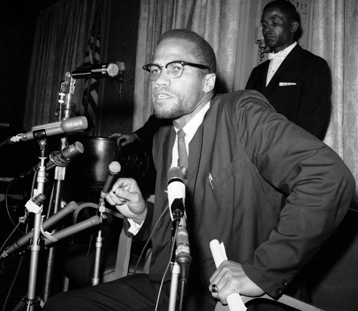 "FILE - In this Feb. 13, 1963 file photo, Nation of Islam leader Malcolm X speaks to the press in New York as Muslims were picketing through the Times Square area. A Smithsonian Channel series, ""The Lost Tapes: Malcolm X,"" examining the life of civil right leader Malcolm X, follows the advocate's changing philosophy using his own words as a Nation of Islam surrogate to a figure seeking to build coalitions during the tumultuous 1960s civil rights era. (AP Photo/Marty Lederhandler, File)"