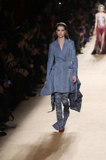 A model wears a creation as part of the Roberto Cavalli women's Fall/Winter 2018-2019 collection, presented during the Milan Fashion Week, in Milan, Italy, Friday, Feb. 23, 2018. (AP Photo/Antonio Calanni)