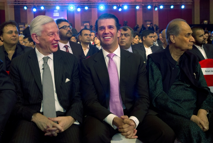 The eldest son of US President Donald Trump, Donald Trump Jr, centre, with Managing Director of McKinsey & Company Dominic Barton, left, and Chairman of Indian conglomerate Bajaj Group Rahul Bajaj at a global business summit in New Delhi, India, Friday, Feb. 23, 2018. The U.S. president's eldest son has heaped praise on the Indian media, while accusing American journalists of unfair criticism, as he nears the end of a whirlwind trip across India promoting Trump-brand luxury real estate. (AP Photo/Manish Swarup)